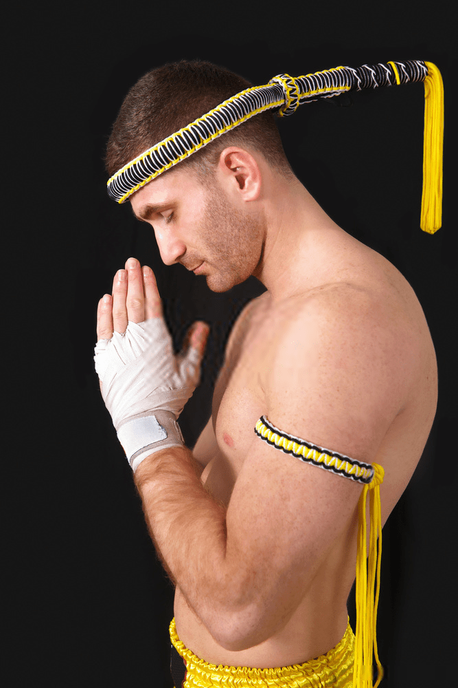 muay thai athlete wearing yellow arm band