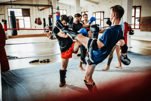 muay thai athletes wearing shin guards & training