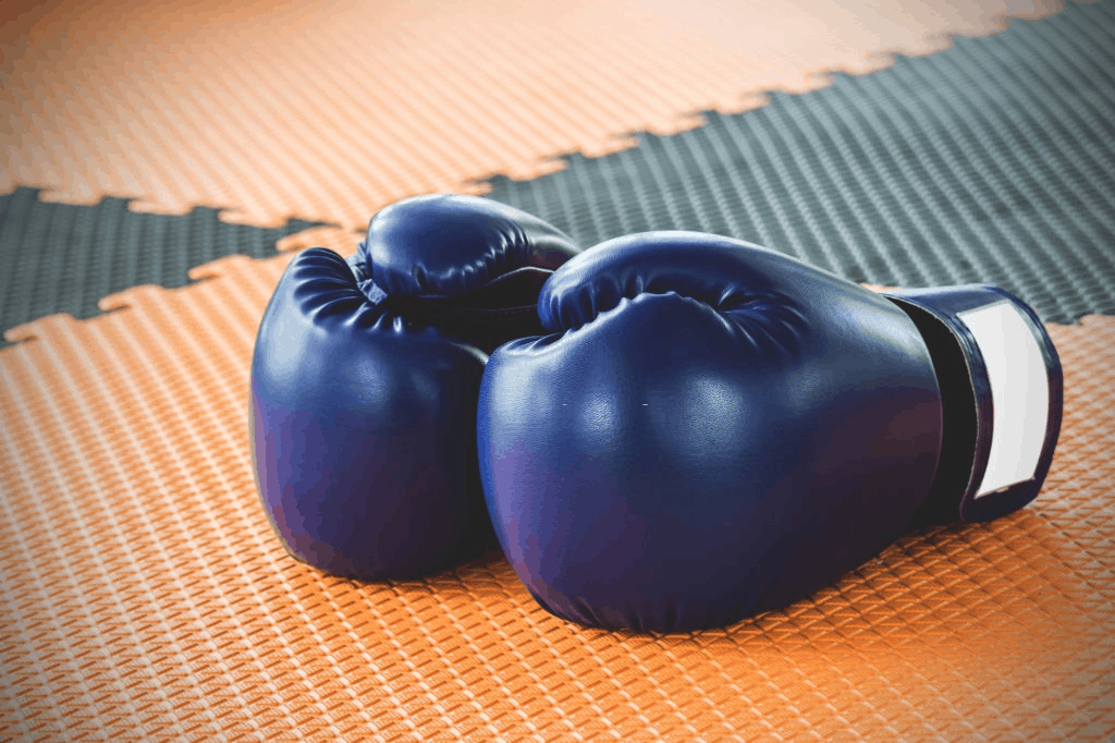 close up of boxing gloves on table
