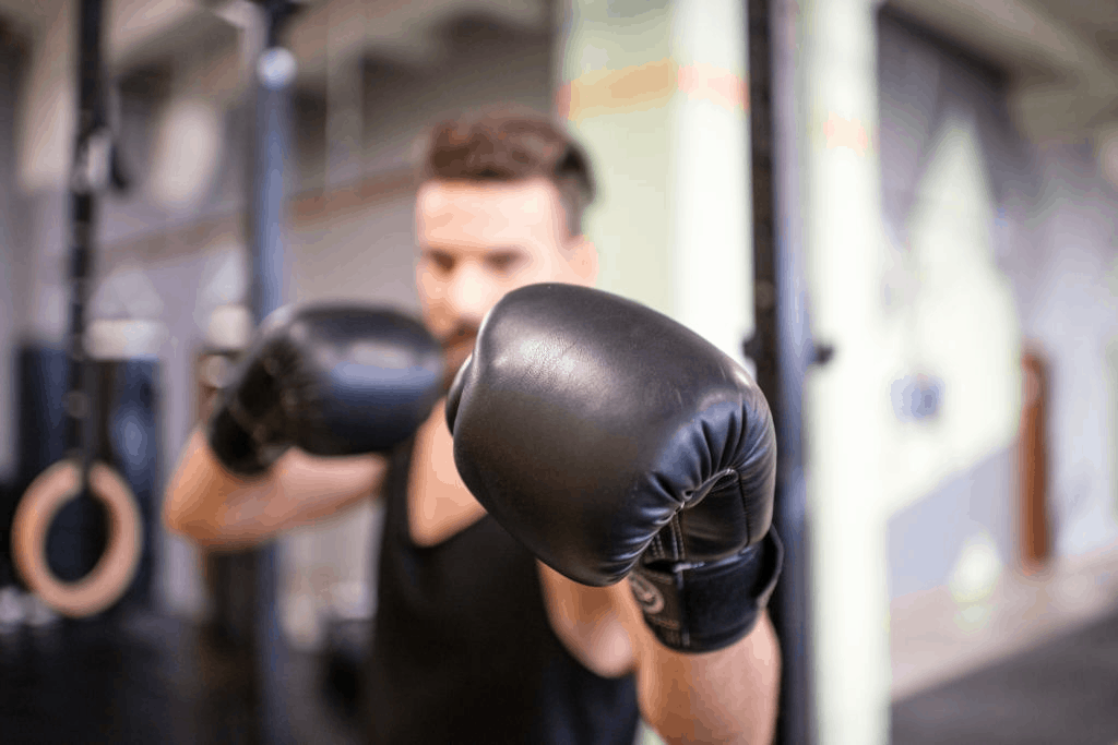 man with boxing gloves at the gym