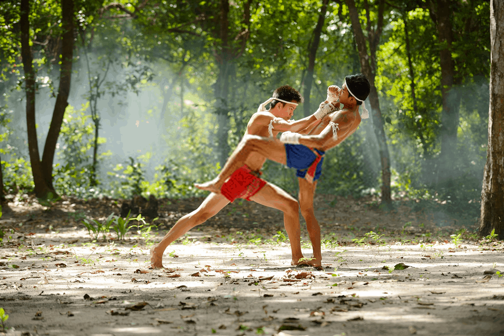 muay thai fighters with hand ropes