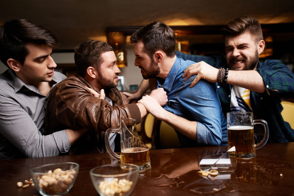 Side view of men having quarrel in pub fighting at counter with broken beer glass