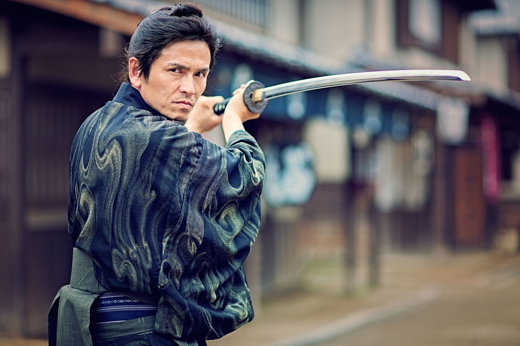 Traditional martial artist in action with weapon