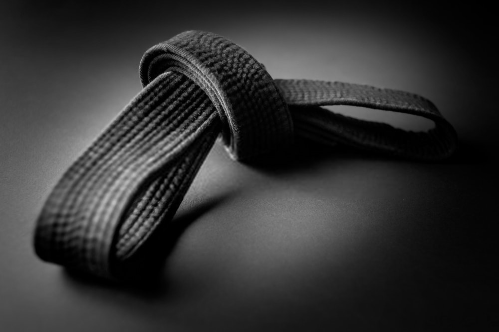 Black belt tied in  a knot