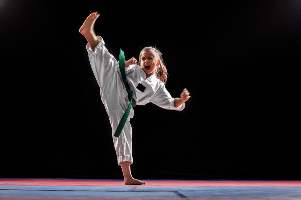 Young girl practicing taekwondo